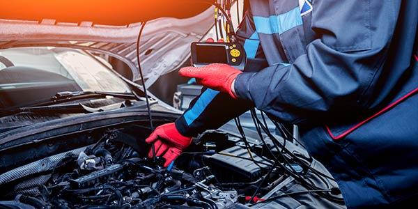 mechanic testing car with probe
