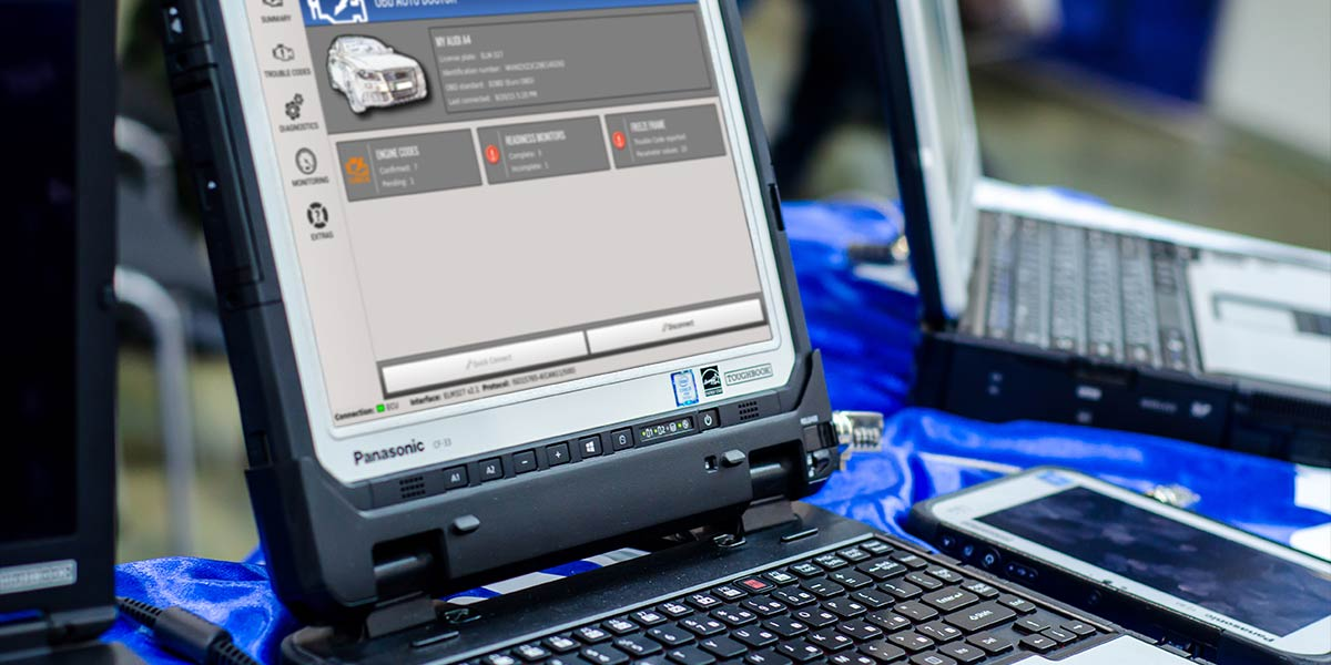 mechanic using car diagnostics screen
